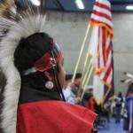 Powwow participant in traditional native clothing